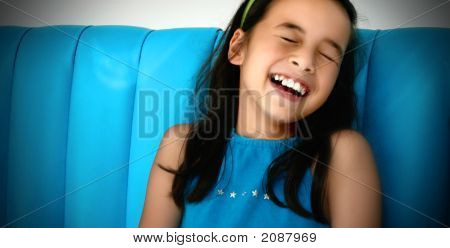 Young Girl Laughing Uncontrollably
