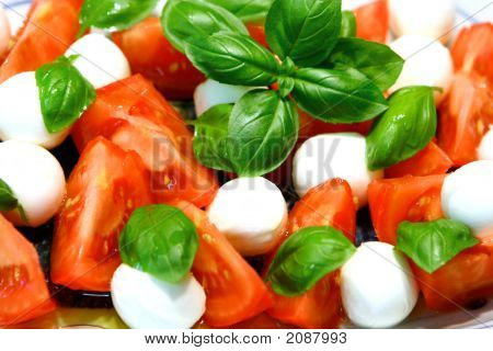 Tricolore Salad Of Mozzarella  Tomatoes And Basil Leaves With Olive Oil