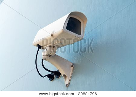 Security Surveillance Camera On A Wall