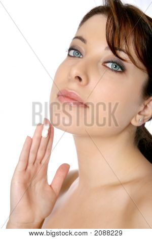 Woman With Face Cream At Tip Of Finger