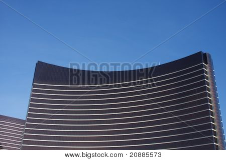 Bright Striped Hotel On Blue Sky