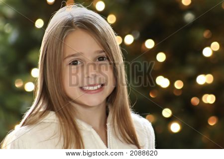 Beautiful Portrait Of A Girl In Front Of Christmas Light Bokeh