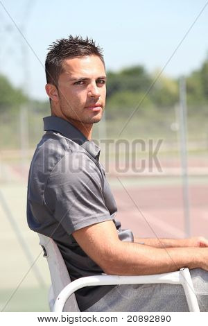 20 years old tennis arbitrator sitting on his armchair