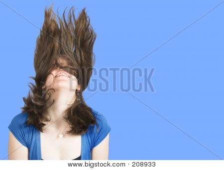 Crazy Womans Hair Over A Blue Background