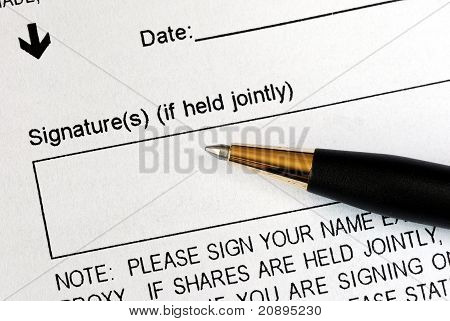 Sign a legal document with a pen