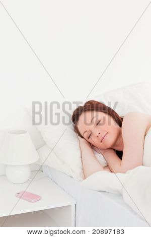 Beautiful Red-haired Woman Relaxing While Lying On Her Bed