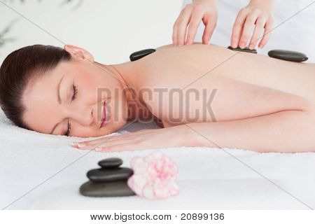 Young Woman Receiving Lastone Therapy