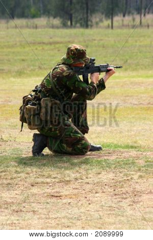 Firing A Rifle On The Range