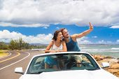 Road trip car people taking phone pictures of nature landscape on summer travel vacation. Tourists c poster