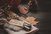 Thanksgiving Decoration With Cutlery And Napkin On The Wooden Table, Close Up poster