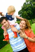 Beautiful Family Having Playful Time Outdoors poster
