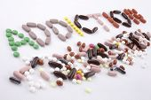 Hand Writing Text Caption Inspiration Medical Care Concept Written With Pills Drugs Capsule Word Dru poster