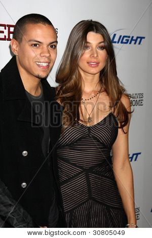 LOS ANGELES - MAR 7:  Evan Ross, Cora Skinner  arrive at the