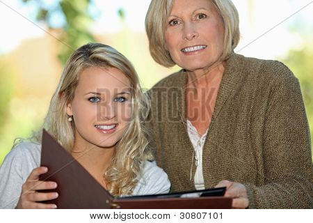 Senior and her granddaughter looking
