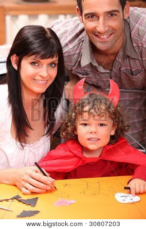 parents and a little boy dressed in devil