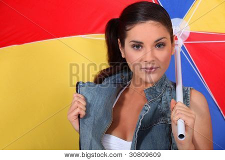 Young woman with a beach umbrella