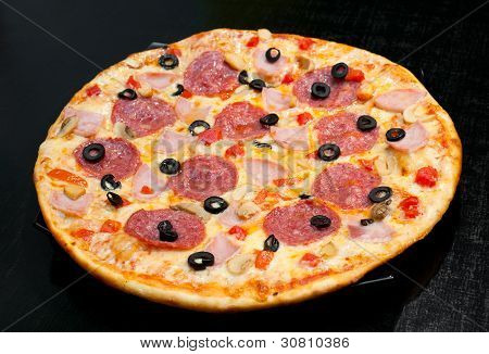 Pizza With Peperoni, Mushrooms And Ham