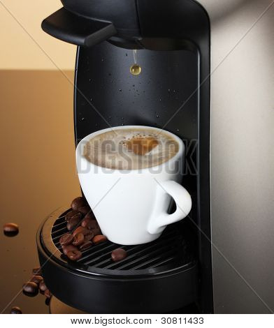 Espresso machine pouring coffee in cup on brown background