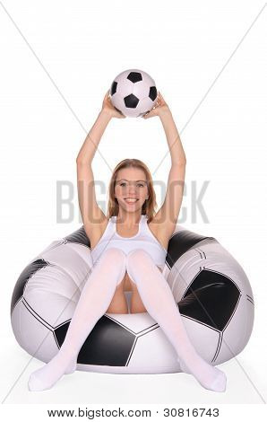 woman with soccer ball on an inflatable chair