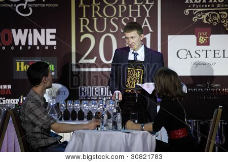 MOSCOW - APRIL 27: Nikolay Utebekov took second place WPTR, on April 27, 2011 in Moscow, Russia. Second prize of National sommelier  competition Wine People Trophy Russia 2011 is $1500.