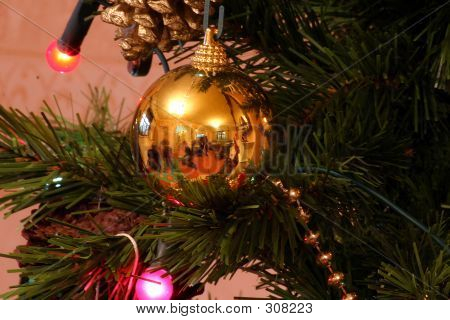 People Playing Reflected In Christmas Tree Ornament