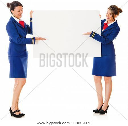 Flight attendants holding a banner ad â?? isolated over a white background