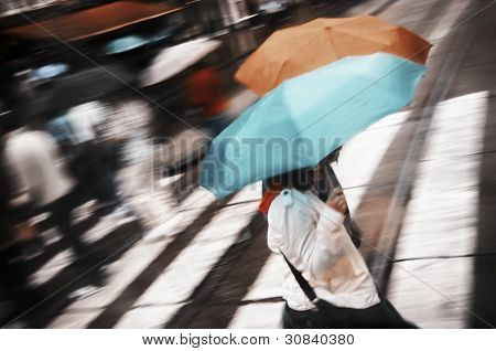 Two women under umbrella crossing
