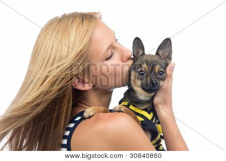 Young Pretty Woman Kissing Small Chihuahua Puppy Dog