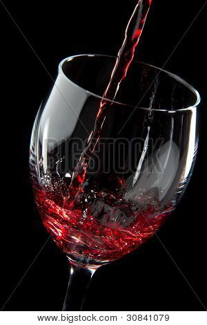 Red Wine Splash On Black Background