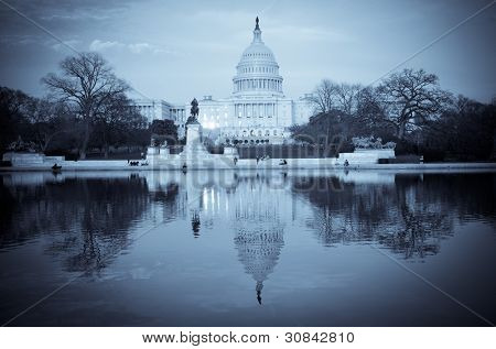 United States Capitol Building with mirror reflection in water - Washington DC - Split tone effect