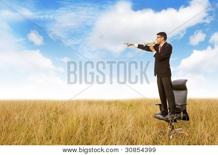 Businessman Shouts Using Megaphone