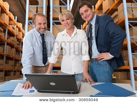Business team with a storage warehouse at the background