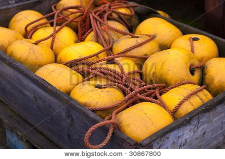 Yellow Buoy In A Wooden Crate