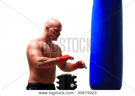 Boxer hitting the sandbag hard isolated