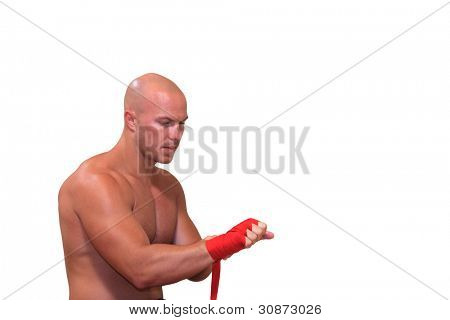 Boxer putting on his gloves isolated
