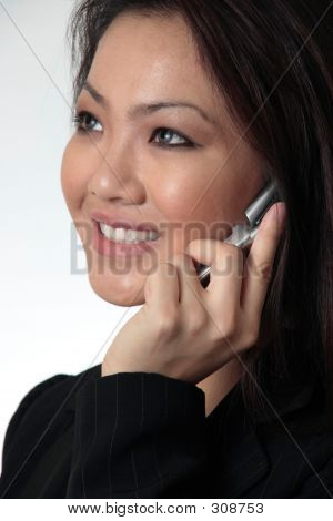 Close--up Of Attractive Business Woman Talking On Cell Phone