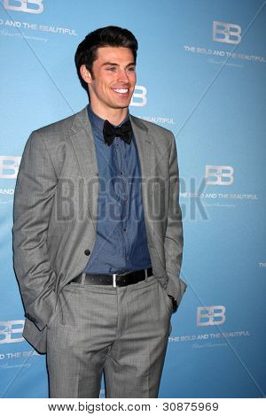 LOS ANGELES - MAR 10:  Adam Gregory arrives at the Bold and Beautiful 25th Anniversary Party at the Perch Resturant on March 10, 2012 in Los Angeles, CA