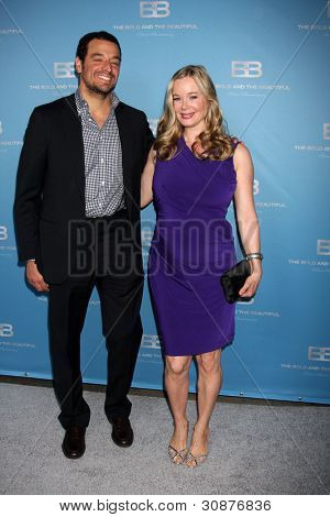 LOS ANGELES - MAR 10:  Bobby Ghassemieh; Jennifer Gareis arrives at the Bold and Beautiful 25th Anniversary Party at the Perch Resturant on March 10, 2012 in Los Angeles, CA
