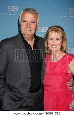 LOS ANGELES - MAR 10:  John McCook; .Laurette Spang arrives at the Bold and Beautiful 25th Anniversary Party at the Perch Resturant on March 10, 2012 in Los Angeles, CA