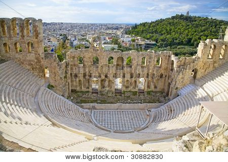 The Odeon of Herodes Atticus on the south slope of the Acropolis in Athens, Greece. c 161 AD.  The city of athens is in the background.