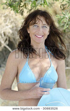 Happy smiling mature woman wearing bikini