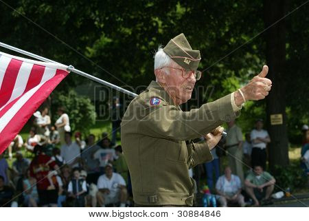 NEW YORK - MAY 29:  An unidentified veteran gestures as he marches in the Little Neck/Douglaston Memorial Day Parade May 29, 2006 in Queens, NY.