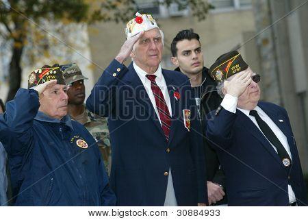 NEW YORK - NOVEMBER 11: War veterans of Whitestone salute at a Veteran's Day Memorial service at St. John's University November 11, 2005 in Queens, NY.