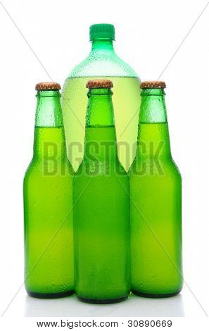 A two liter plastic lemon lime soda bottle behind three small glass bottles. Vertical format over white with reflection.
