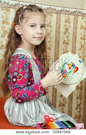 The Girl Embroiders Figure