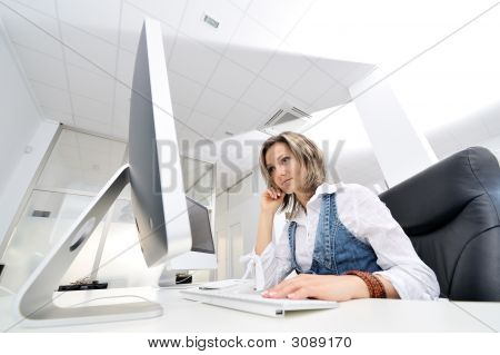 Beautiful Young Woman Working At The Office