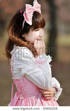 japanese in sweet lolita cosplay outdoor portrait