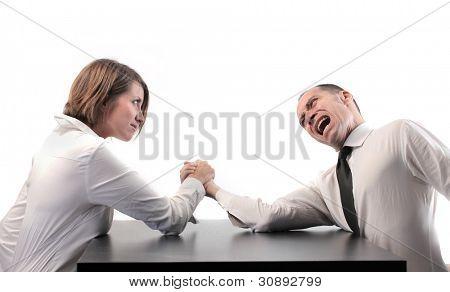 Businesswoman winning at arm wrestling