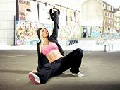 image of kettlebell  - Young adult fitness woman focusing on lifting a heavy weight - JPG