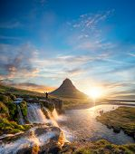 Man silhouette standing in front of famous Kirkjufell mountain, Iceland. Travel concept, leasure act poster